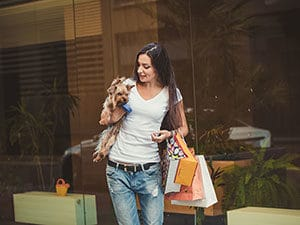 woman shopping with dog