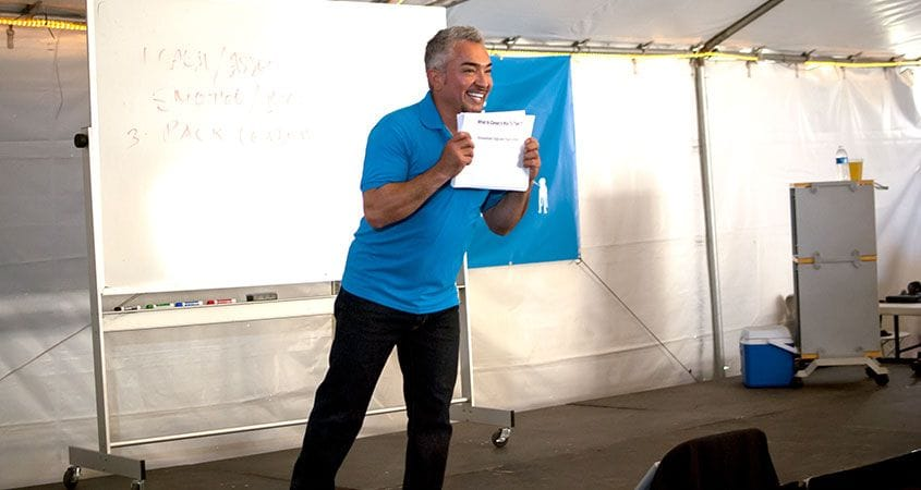 Cesar Millan with a sign   are you listening?