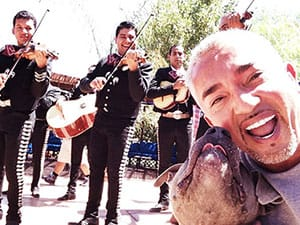 Cesar with dog and band