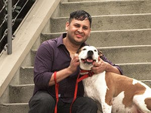 George Gomez with a dog