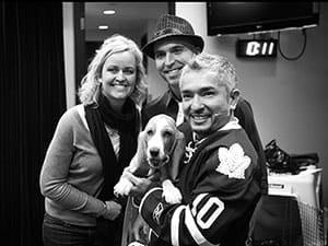 three people with dog