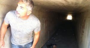 Cesar Millan in dark tunnel