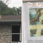 Family Puts Up A Sign For Neighbors That Are Concerned About Their Dog On The Roof